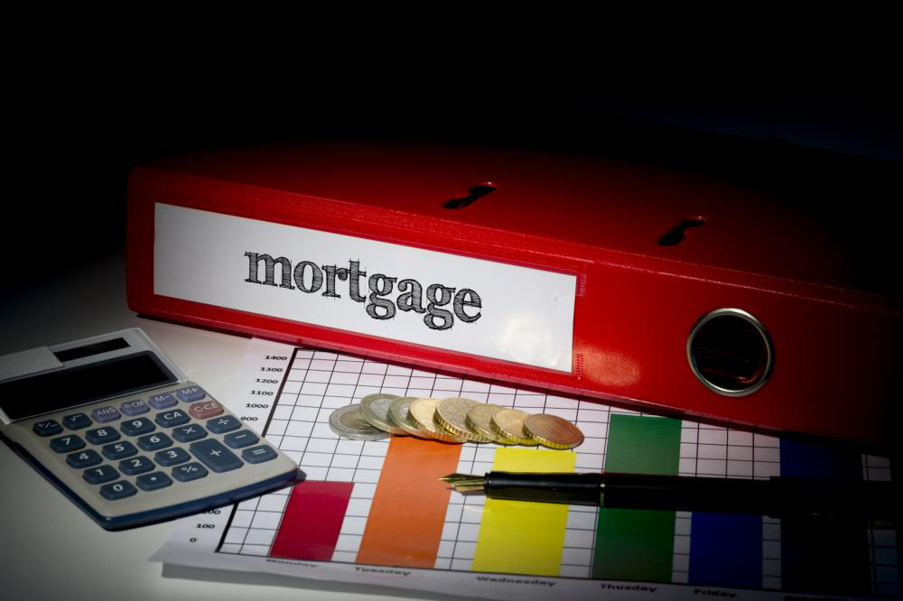 Calculating mortgage with a calculator and necessary paperwork