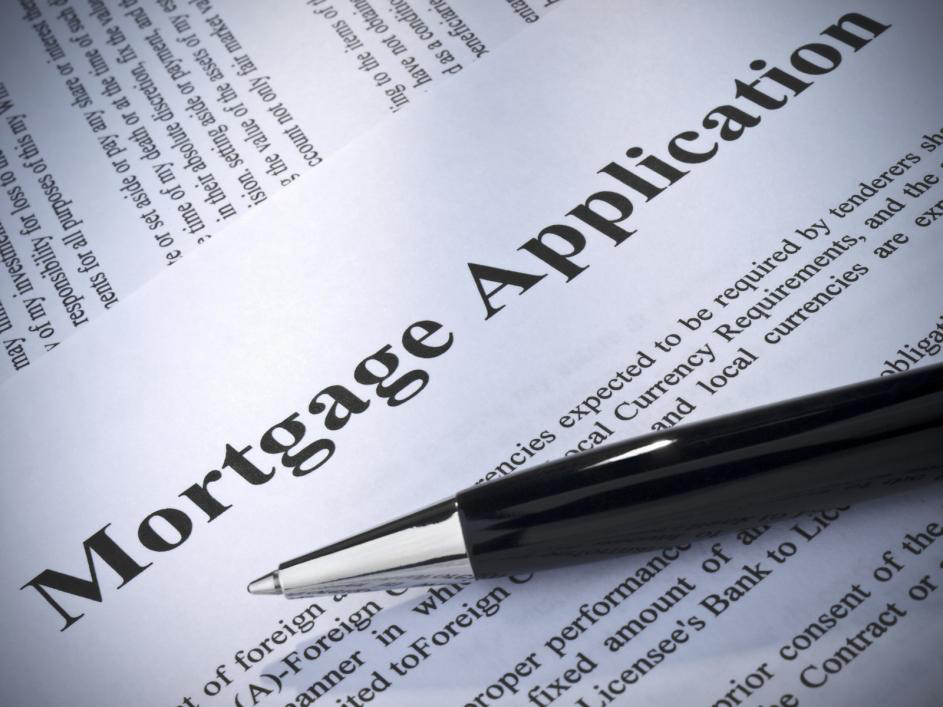 A mortgage application with a pen on top