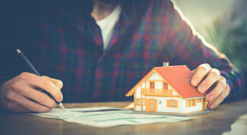 A home owner calculating the market value of his home for mortgage