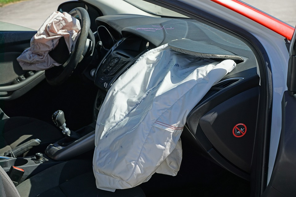 a car with deployed airbags following a rear-end collision