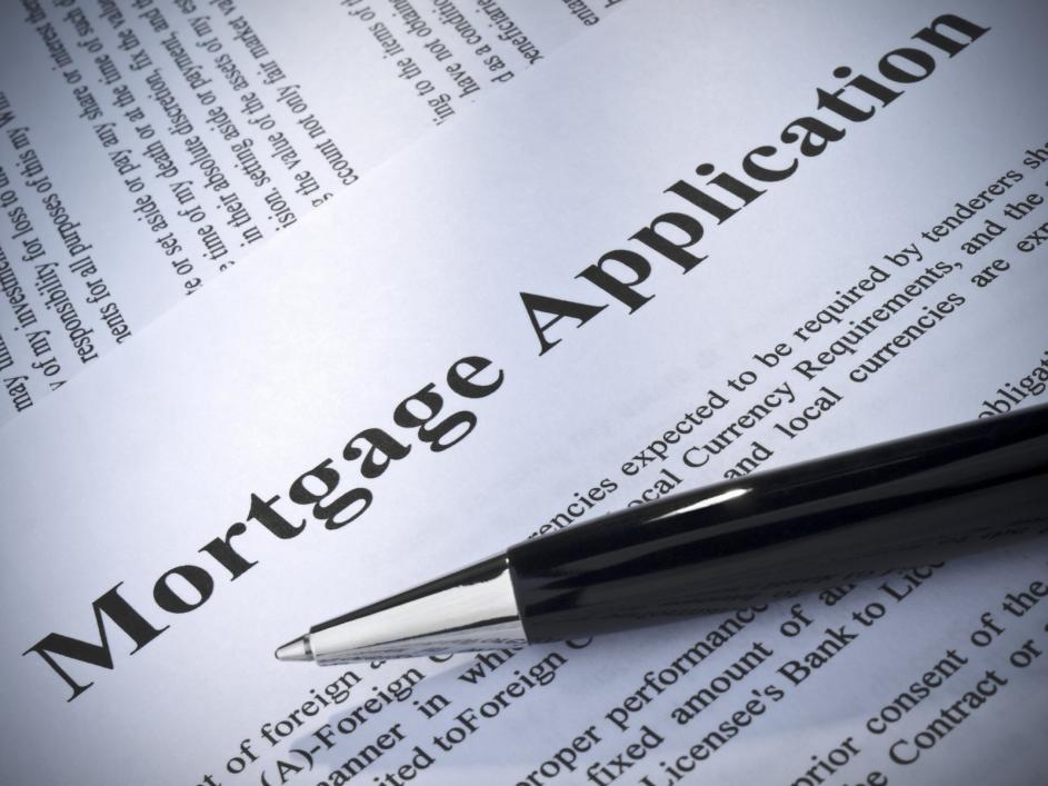 A pen lying on top of a mortgage application
